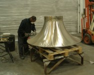 The stainless steel casting being polished