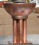 The bronze font before patination